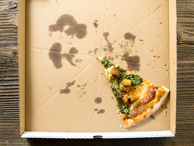 A pizza box or potential cardboard turntable.